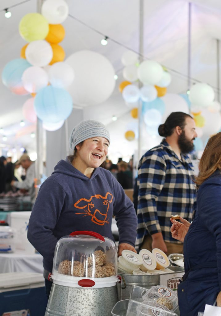 Carrie Whitcomb of Springdale Farm in Waldo sells cream cheese at Market on the Harbor, the grand finale of the annual Harvest on the Harbor.