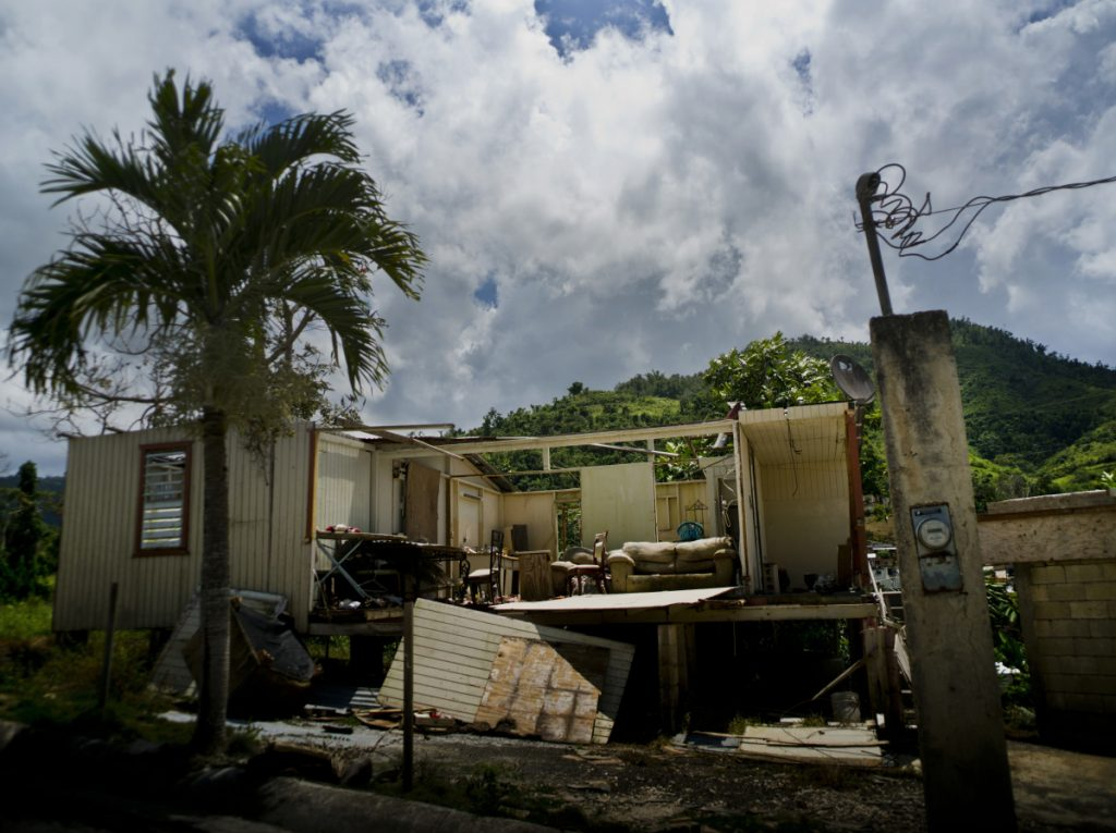 A home abandoned after Hurricane Maria hit a year ago is still full of furniture Sept. 8 in Morovis, Puerto Rico. The U.S. territory has been in a recession for 12 years and has over $70 billion in public debt.