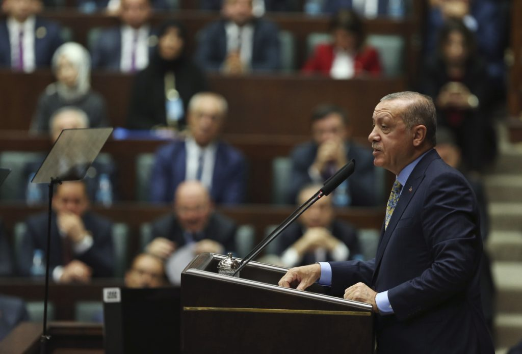 Turkey's President Recep Tayyip Erdogan addresses members of his ruling Justice and Development Party, in Ankara, Turkey on Tuesday. Turkey's president says Saudi officials started planning to murder Saudi writer Jamal Khashoggi days before his death in Saudi Arabia's Istanbul consulate.