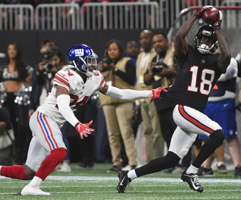 Falcons wide receiver Calvin Ridley hauls in a catch against Giants cornerback Eli Apple during Monday night's game in Atlanta. The Falcons won 23-20.
