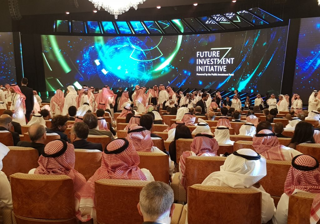 "Participants take their seats Tuesday during the opening day of the Future Investment Initiative conference, also known as ""Davos in the Desert,"" at the Ritz Carlton Hotel in Riyadh, Saudi Arabia."