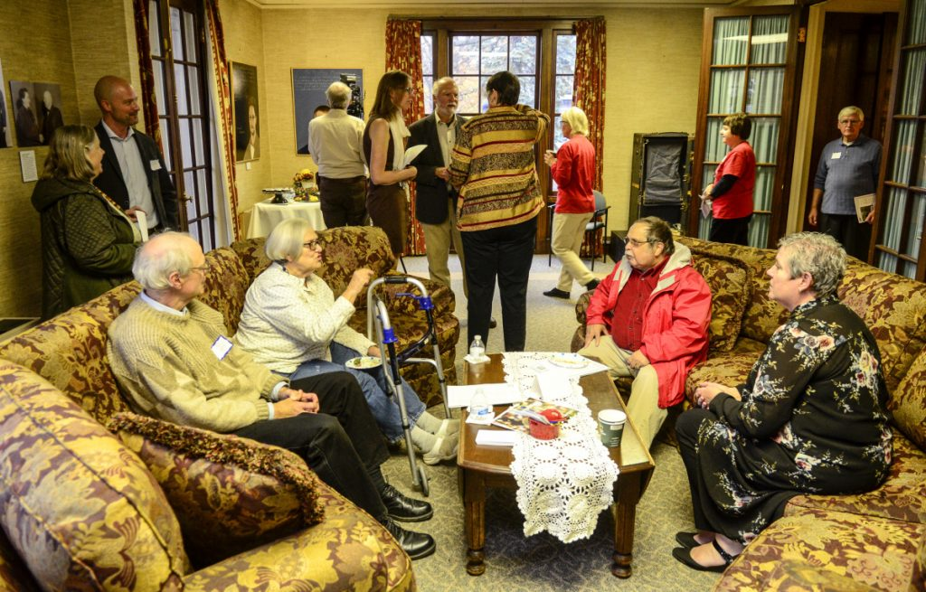 People chat in a downstairs room Tuesday at the First Amendment Museum in Augusta. Staff photo by Joe Phelan
