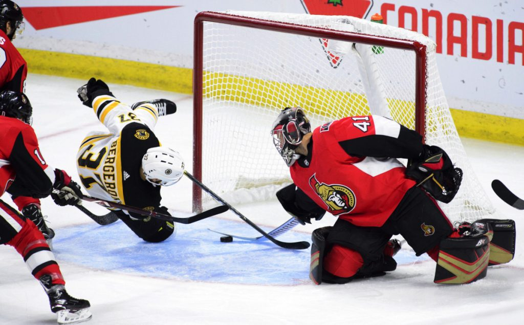 Ottawa goaltender Craig Anderson makes a save on Bruins center Patrice Bergeron in the first period Tuesday night in Ottawa, Ontario.