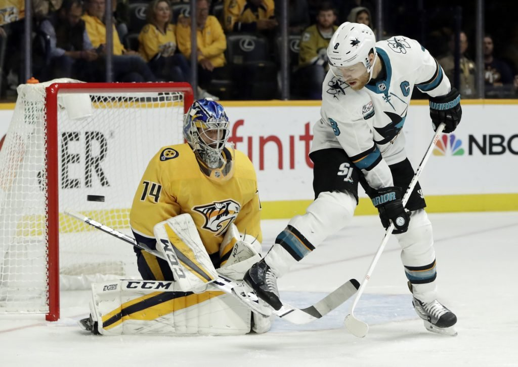 San Jose's Joe Pavelski tries to deflect a shot as it goes wide of the net on Nashville goaltender Juuse Saros in the first period Tuesday night at Nashville, Tenn.