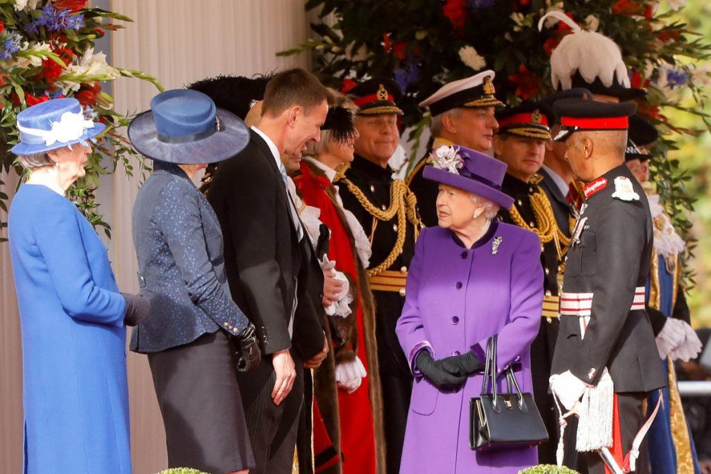 Britain's Queen Elizabeth II, center, speaks with Theresa May, U.K. prime minister, second left, and Jeremy Hunt, U.K. foreign secretary, third left, at a ceremonial arrival event to welcome Dutch King Willem-Alexander and Queen Maxima for their state visit to London on Tuesday.