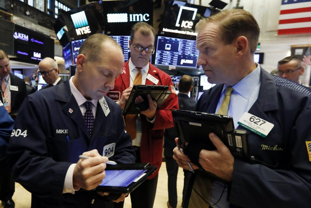 "Michael Urkonis, from left, William Lawrence and Michael Smyth work at the New York Stock Exchange on Monday. ""Investors are on pins and needles,"" said a Wells Fargo Private Bank official."