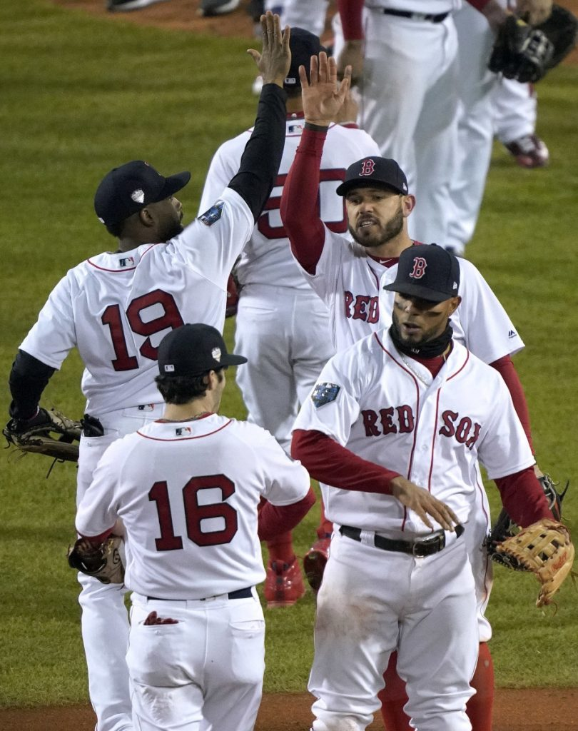 The Boston Red Sox celebrate after their 4-2 win over the Los Angeles Dodgers in Game 2 of the World Series on Wednesday in Boston. (AP Photo/Elise Amendola)