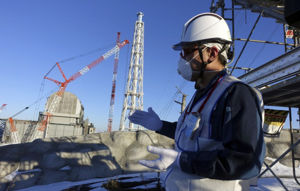 A Tokyo Electric Power official discusses the Fukushima Dai-ichi nuclear power plant last January.