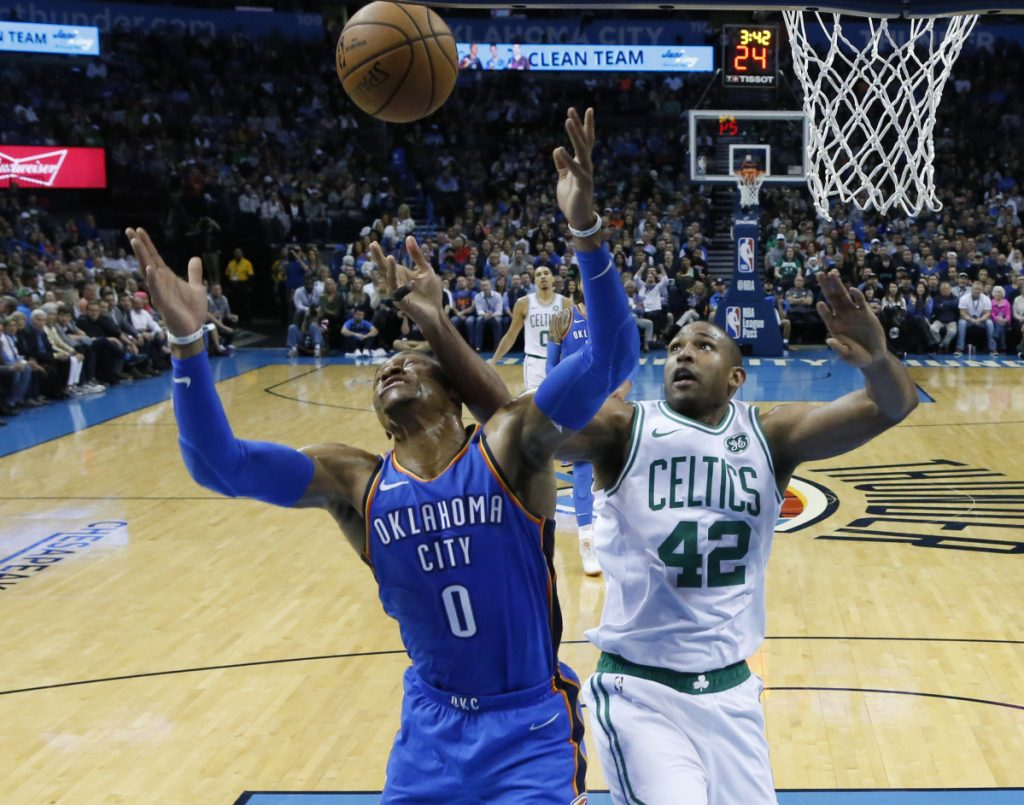 Oklahoma City's Russell Westbrook and Boston's Al Horford reach for a rebound in the first half Thursday night in Oklahoma City.
