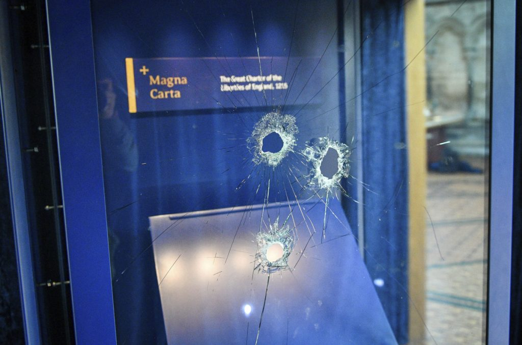 Hammer holes in the glass case that housed the Magna Carta after a robbery attempt o  Thursday.
