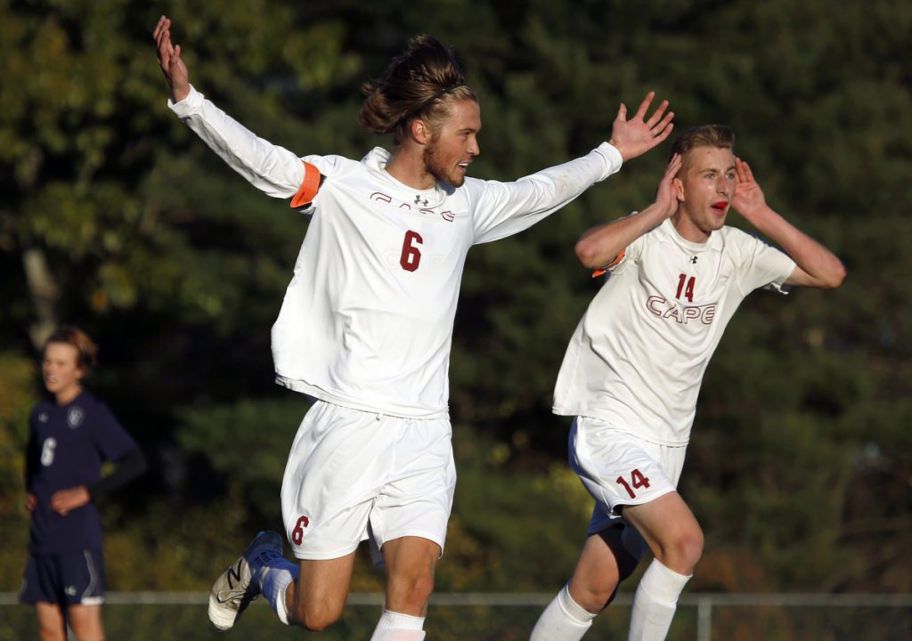 Phil Tarling, center, celebrates with John O'Connor after scoring the goal that gave Cape Elizabeth a 2-0 lead on the way to a 2-1 win that broke Yarmouth's 45-game unbeaten run in a Class B South semifinal.