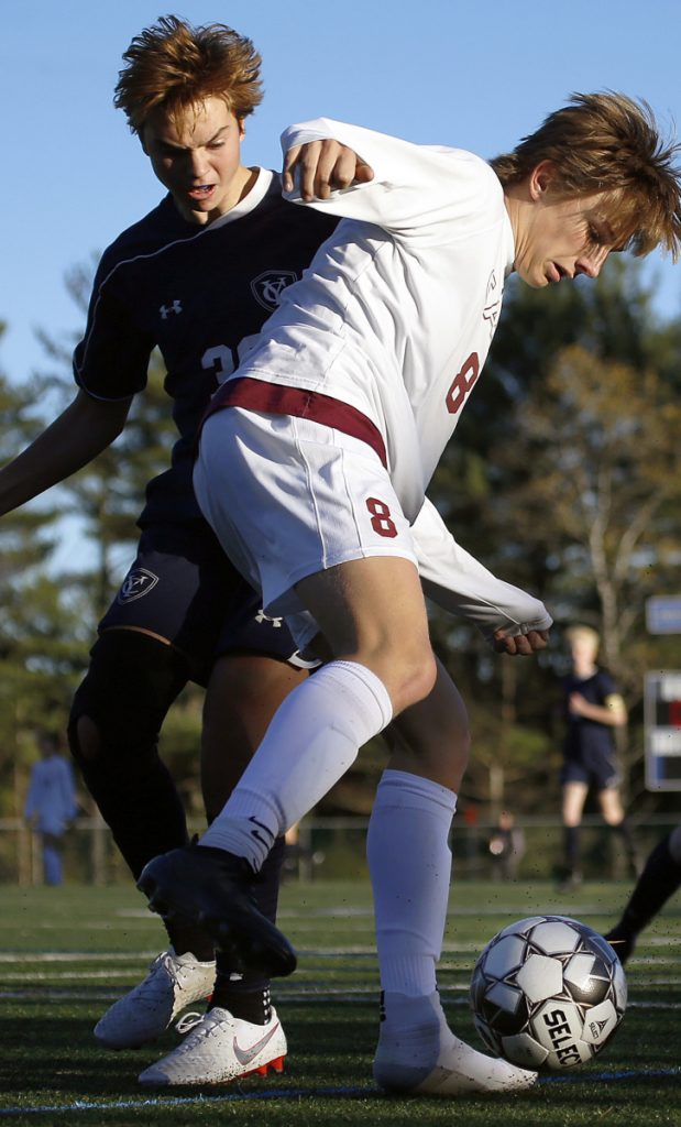 Archie McEvoy of Cape Elizabeth, right, and John Clinton of Yarmouth compete for possession Friday. Cape Elizabeth will be at Freeport in the Class B South championship game Wednesday.