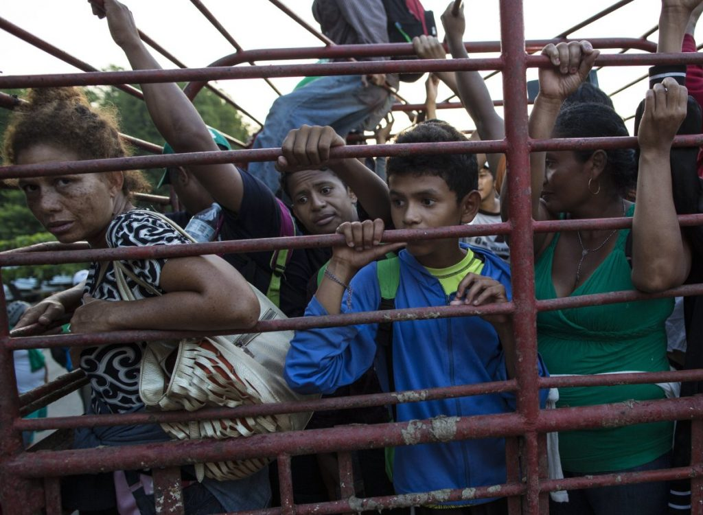 Migrants travel on a cattle truck Friday in Mexico, as a thousands-strong caravan of Central American migrants slowly makes its way toward the U.S. border. Associated Press/Rodrigo Abd