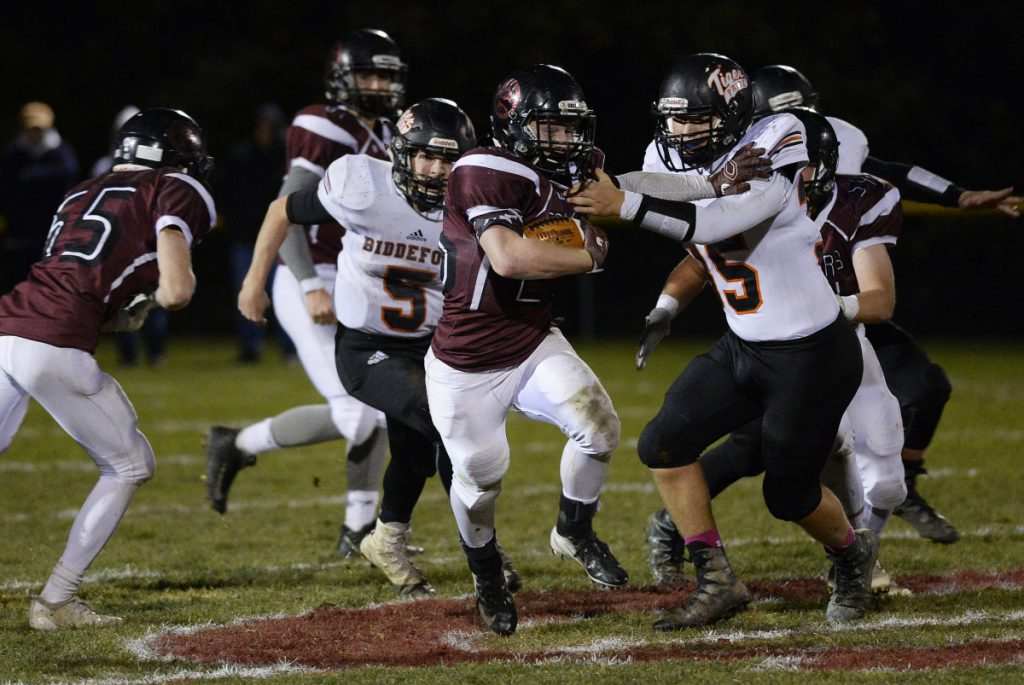 Staff photo by Shawn Patrick Ouellette Greely's Joey Cassella tries to break free from Biddeford's Alex McAlevey during the Rangers' 22-14 win in the Class B South quarterfinals on Friday in Cumberland.