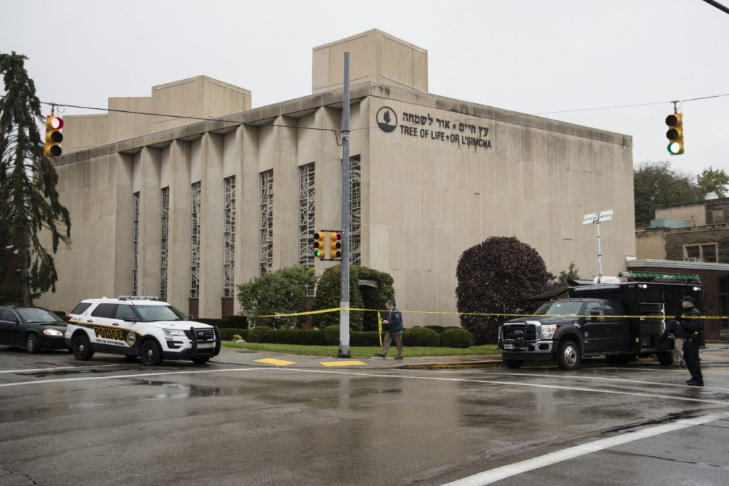 Police stand guard outside the Tree of Life synagogue in Pittsburgh where a shooter opened fire Saturday.
