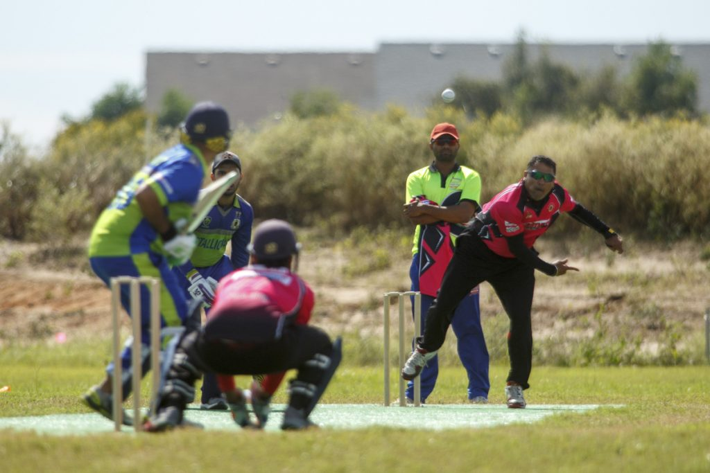 Bowler and batsman square off during a championship game on Oct. 21 at the nascent Prairie View Cricket Complex outside Houston. (Photo for The Washington Post by Michael Stravato)