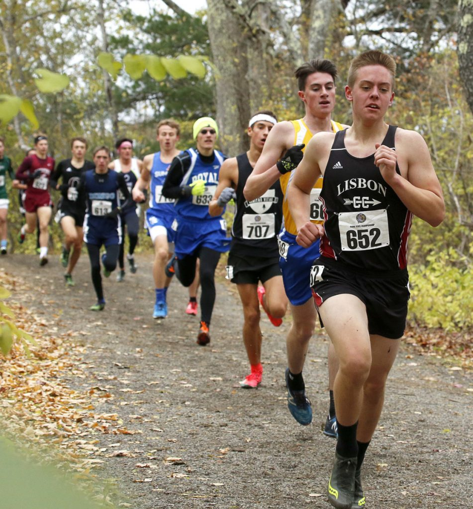 Runners form a line behind Lisbon's David Schlotterbeck during the Class C boys' race. Schlotterbeck finished sixth, about 30 seconds behind winner Henry Spritz of Waynflete.