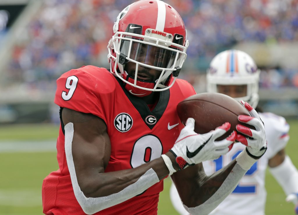 Georgia wide receiver Jeremiah Holloman catches a 16-yard touchdown pass in front of Florida defensive back C.J. McWilliams during the first half of the Bulldogs' 36-17 win at Jacksonville, Florida on Saturday.