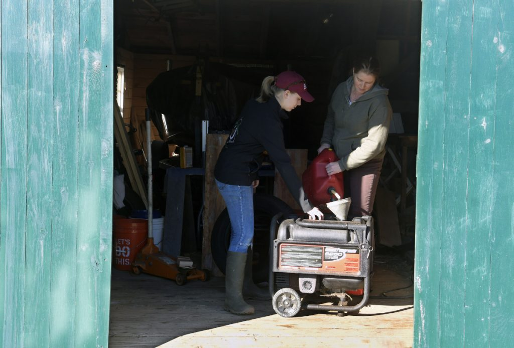 Emma Christman, 17, helps her mother, Jana, fuel a generator in the shed at their Litchfield home on Oct. 31, 2017.