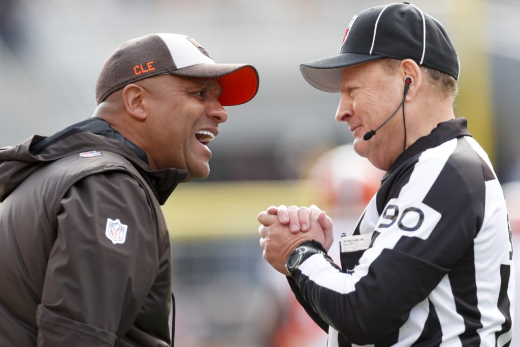 Cleveland Browns head coach Hue Jackson, left, talks with line judge Mike Spanier along the sideline as his team plays against the Pittsburgh Steelers on Sunday in Pittsburgh. The Steelers won 33-18. Jackson was fired Monday.