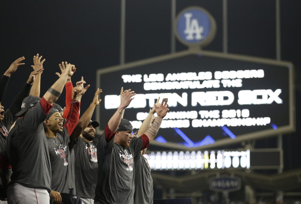 The Boston Red Sox celebrate after Game 5 of the World Series on Sunday in Los Angeles. The Red Sox beat the Dodgers, 5-1, to win the series 4 games to 1. (AP Photo/Jae C. Hong)