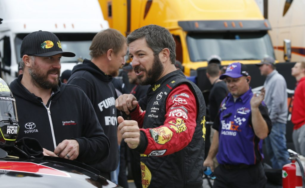 Martin Truex Jr., front right, talks to a crew member before qualifying for last Sunday's Cup Series race in Martinsville, Va., where Truex lost on Joey Logano's late bump-and-run.