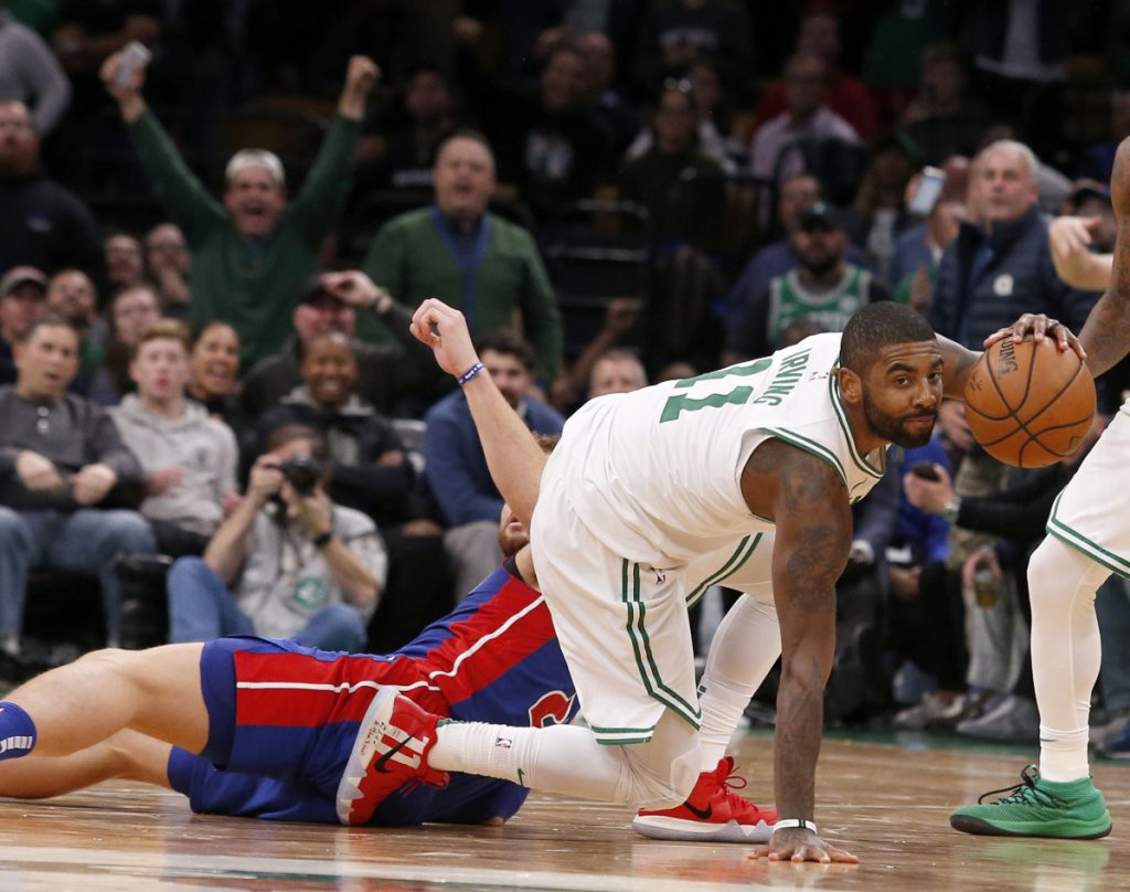 Boston's Kyrie Irving steals the ball from Detroit's Blake Griffin late in the fourth quarter Tuesday night in Boston. Irving had 31 points in Boston's 108-105 win.