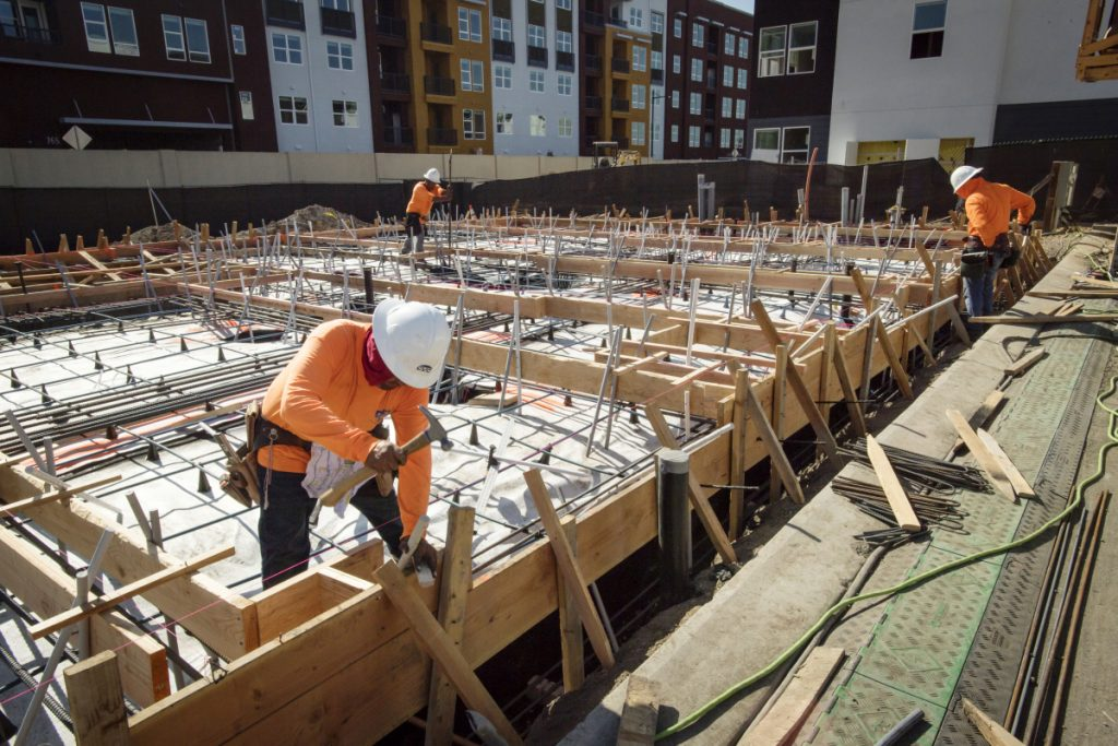 Contractors work on townhouses in Milpitas, Calif., on Thursday.