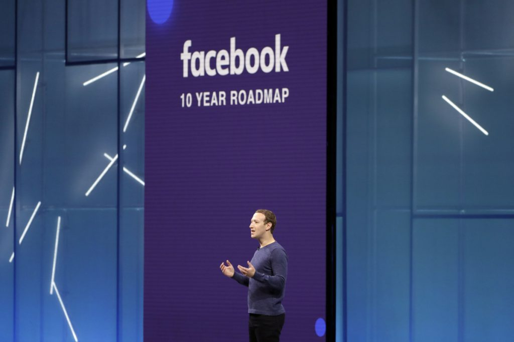 Facebook CEO Mark Zuckerberg speaks at F8, Facebook's developer conference in San Jose, Calif., in May. The company is spending heavily to boost security, moderating content and investing in new technologies such as artificial intelligence.