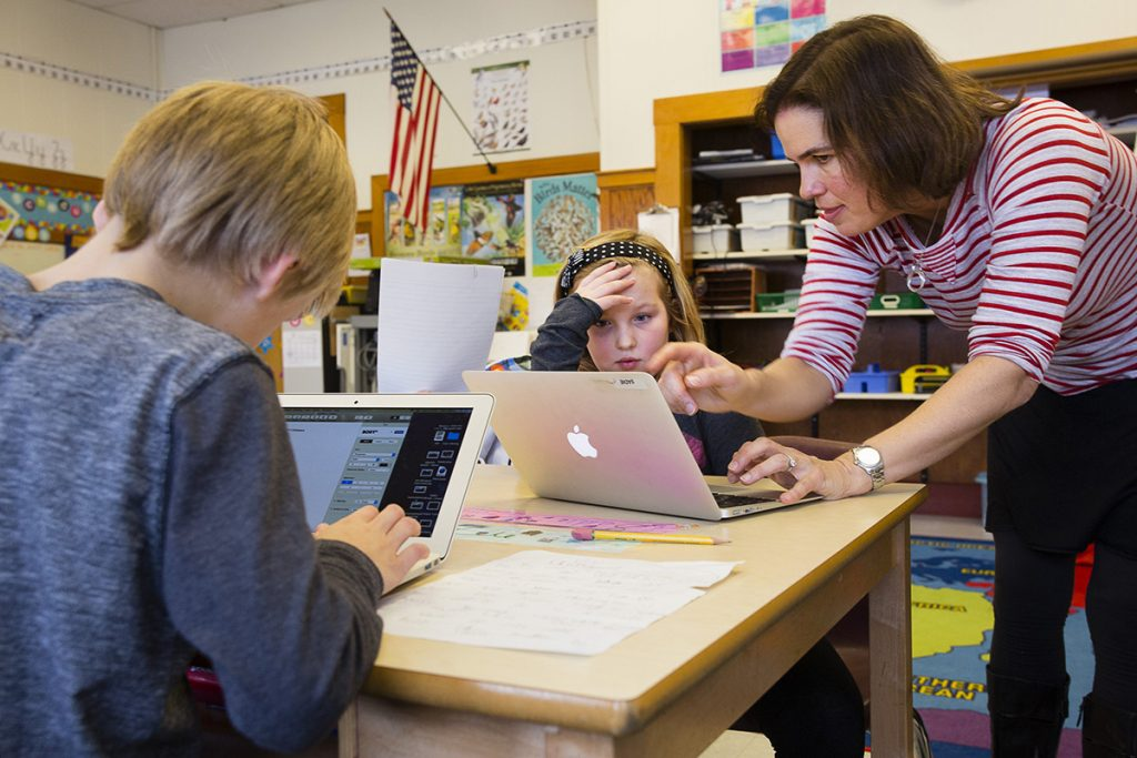 In this file photo from 2016, a Chebeague Island School third grader receives assistance from teacher Kristin Westra. Westra has been missing since Sunday night and a search is being conducted.