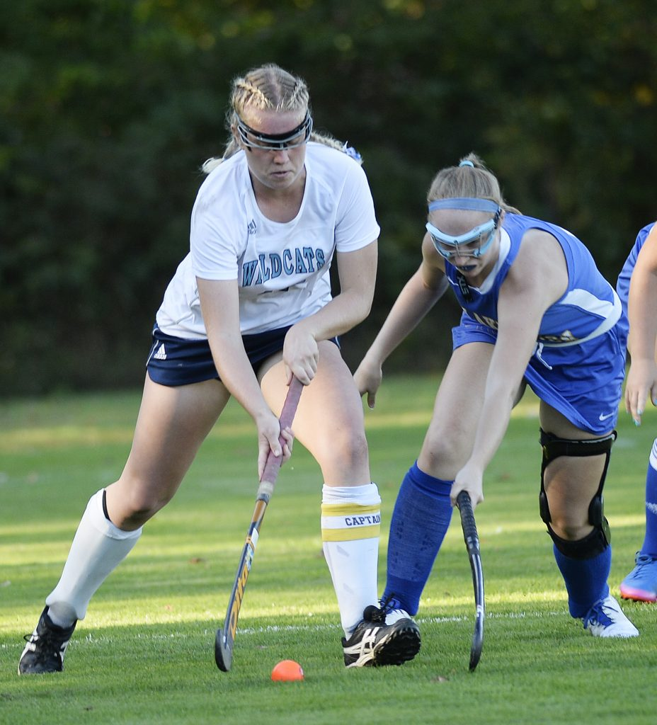 York's Emlyn Patry tries to control the ball away from Lake Region's Kaitlyn Plummer.