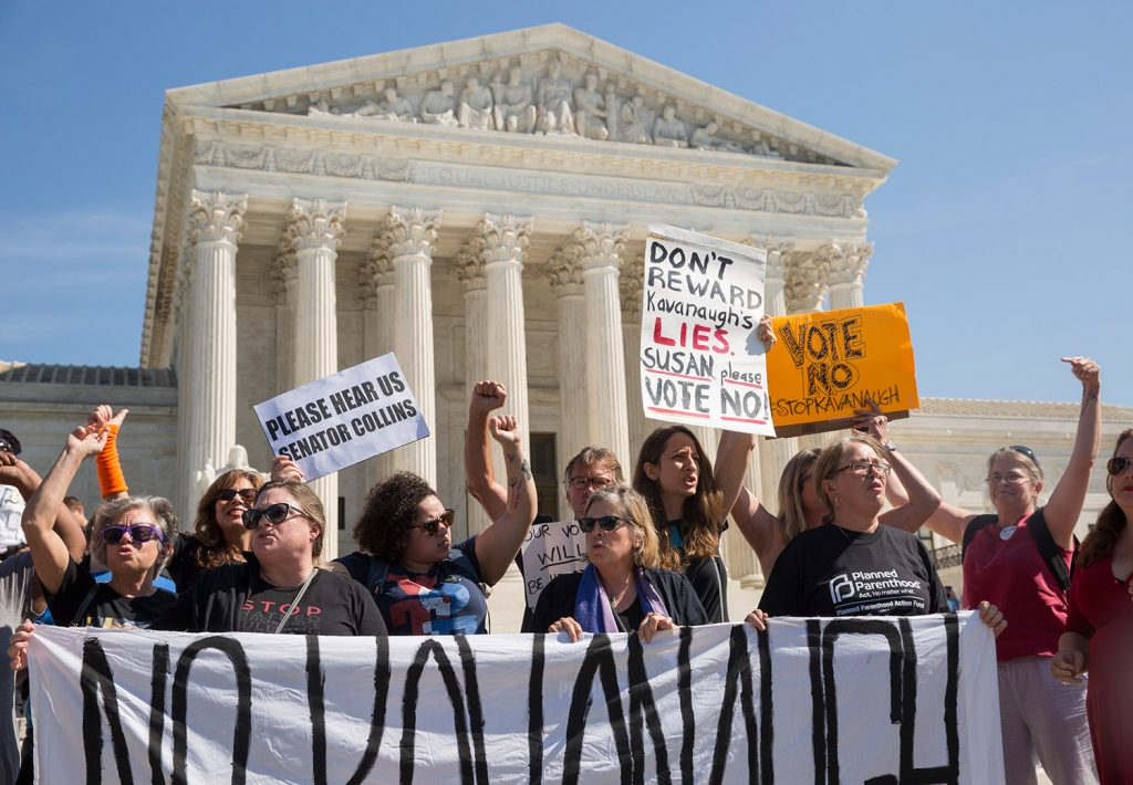 """Demonstrators from Maine chant """"Susan Collins, we're your voters"""" at a rally against Brett Kavanaugh on Thursday outside the Supreme Court in Washington, D.C."""