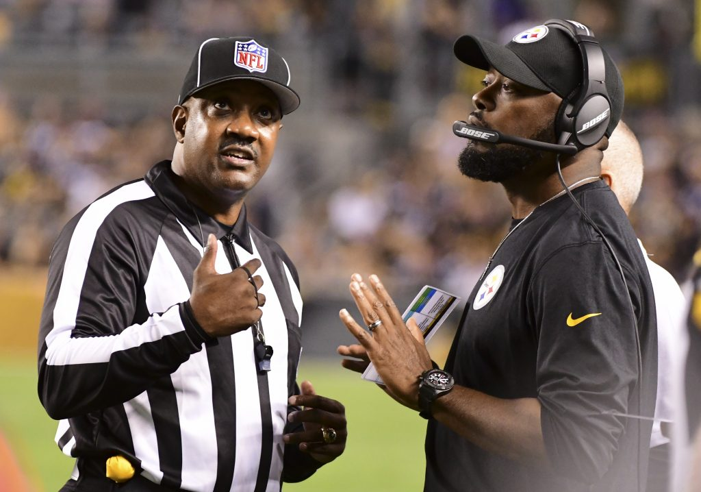 Pittsburgh Steelers head coach Mike Tomlin, right, talks with an official during the first half of the Steelers 26-14 loss to Baltimore on Sunday.