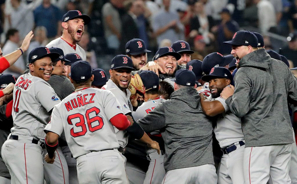 The Red Sox celebrate after beating the Yankees 4-3 and clinching the American League Division Series on Tuesday night in New York.
