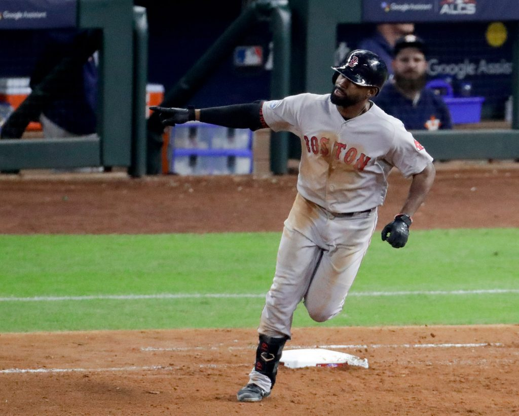 Boston Red Sox's Jackie Bradley Jr., celebrates his two-run home run in the sixth inning of Game 4 of the American League Championship Series on Wednesday night in Houston.