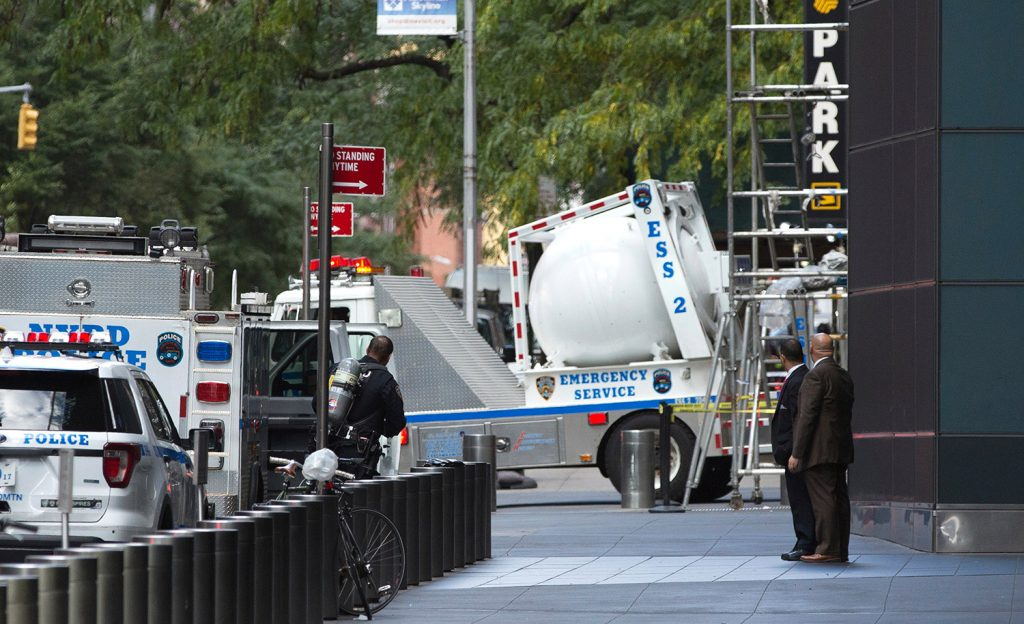 A New York police bomb squad vehicle leaves an area outside Time Warner Center on Wednesday after a package containing a pipe bomb prompted an evacuation of CNN's offices.