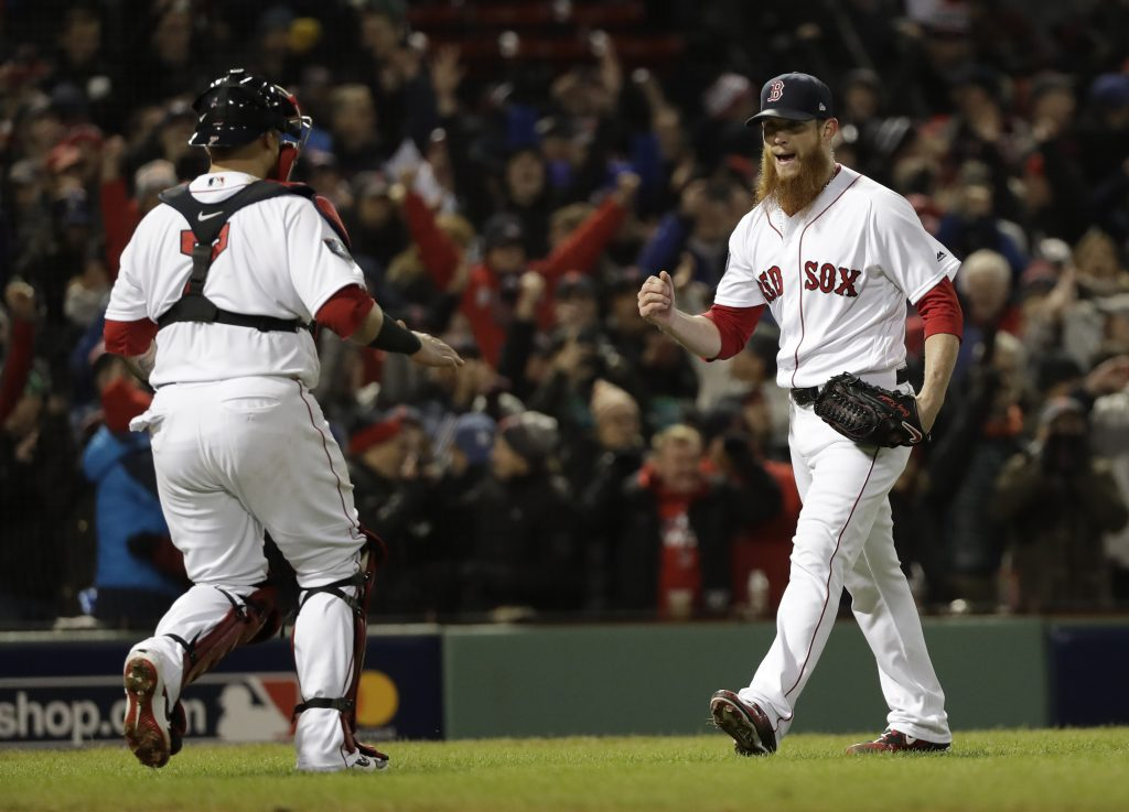 Boston Red Sox pitcher Craig Kimbrel celebrates with Christian Vazquez at the final out during the ninth inning of Game 2 of the World Series baseball game against the Los Angeles Dodgers Wednesday, Oct. 24, 2018, in Boston. The Red Sox won 4-2 to take a 2-0 lead in the series. (AP Photo/David J. Phillip)