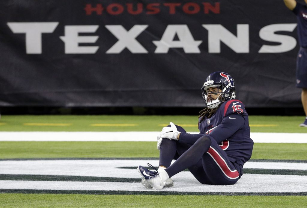 Houston Texans wide receiver Will Fuller (15) holds his knee during the second half of an NFL football game against the Miami Dolphins on Thursday in Houston.