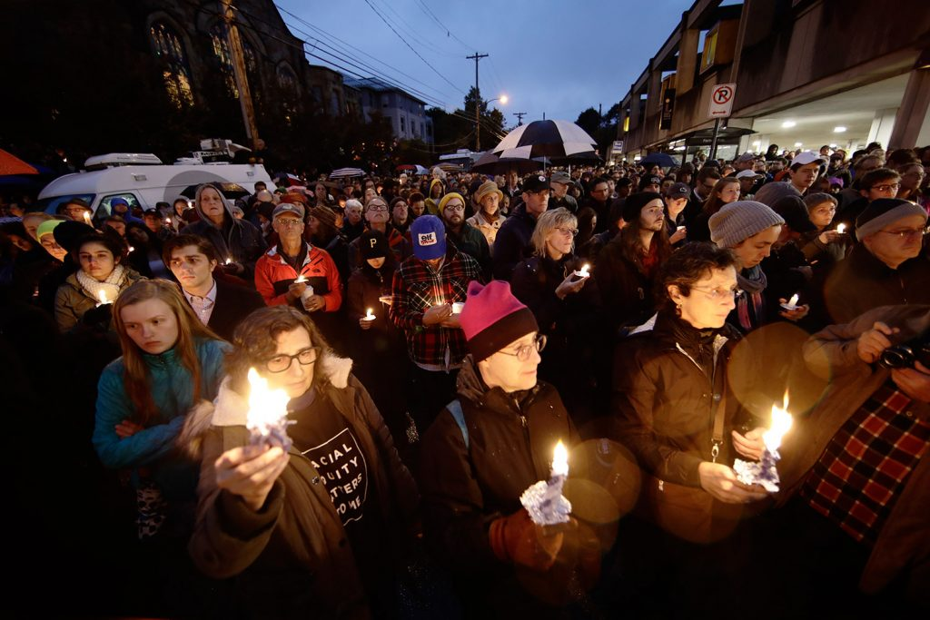 People hold candles as they gather for a vigil in the aftermath of a deadly shooting at the Tree of Life Congregation, in the Squirrel Hill neighborhood of Pittsburgh, on Saturday.