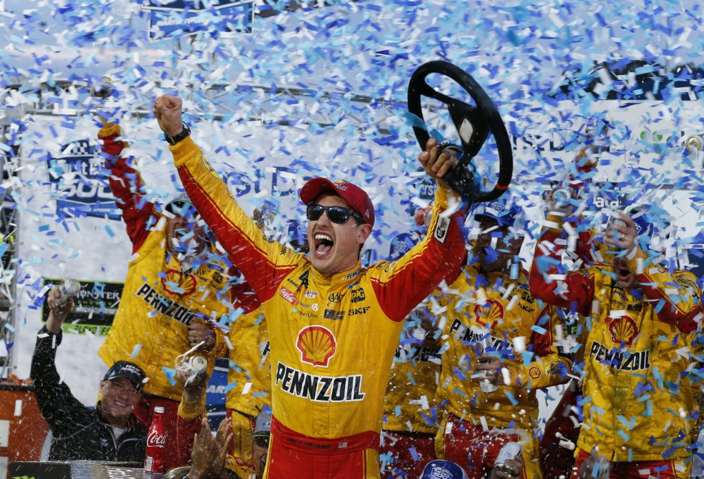 Joey Logano celebrates winning the NASCAR Cup Series race at Martinsville Speedway on Sunday in Martinsville, Va.