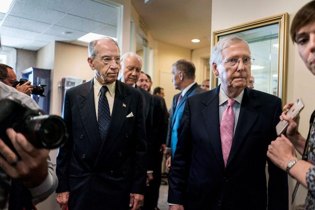 "Senate Judiciary Committee Chairman Chuck Grassley, R-Iowa, and Senator Majority Leader Mitch McConnell, R-Ky., enter a press conference Thursday about Judge Brett Kavanaugh's nomination to the Supreme Court. Grassley said the new FBI report on Kavanaugh included ""no hint of misconduct."""
