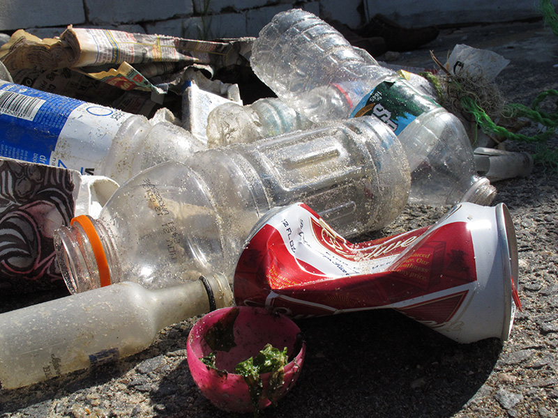 Beer, liquor, water and soft drink bottles, along with half a plastic Easter egg collected by volunteers in a 2012 beach cleanup in New Jersey.