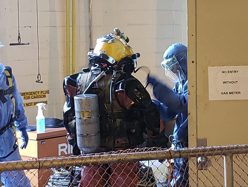 Divers get ready to deep dive into the sewer, to pull out huge balls of oily, black used wet wipes and baby wipes that had clogged intake pumps in Charleston, S.C.