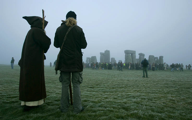 A worshipper of the Pagan Wiccan religion, left, and a friend stand near the ancient stone monument of Stonehenge in 2006. Canada's law originated from a British statute from 1735,