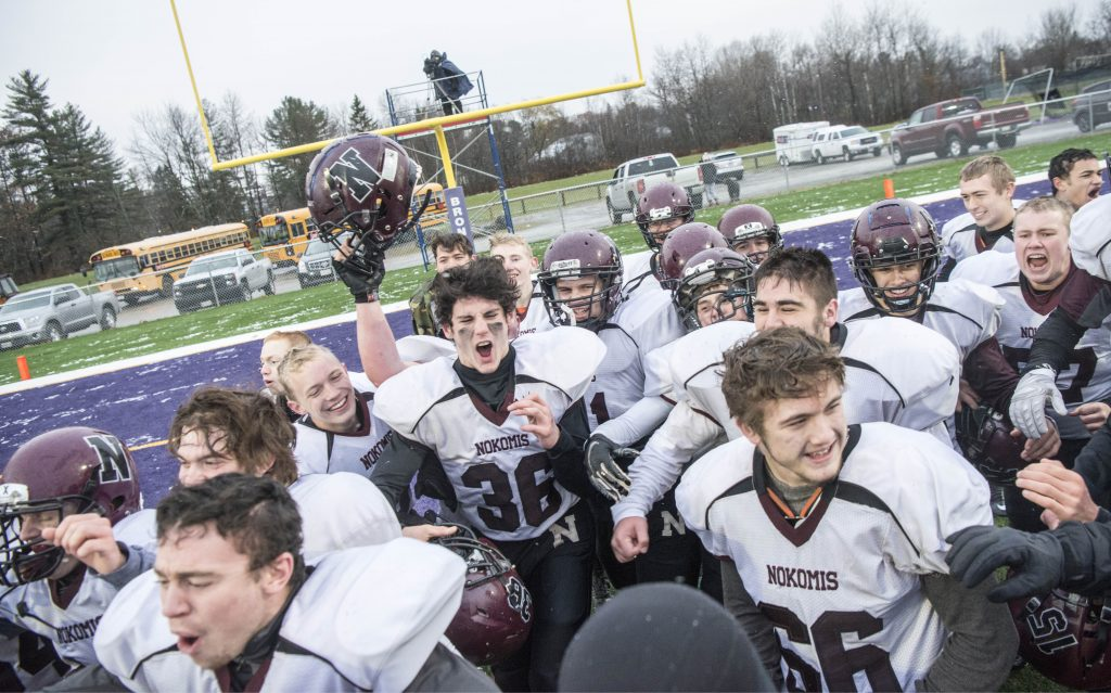 Nokomis celebrates after beating Hampden Academy 13-6 to win the Class C North final on Saturday in Hampden.