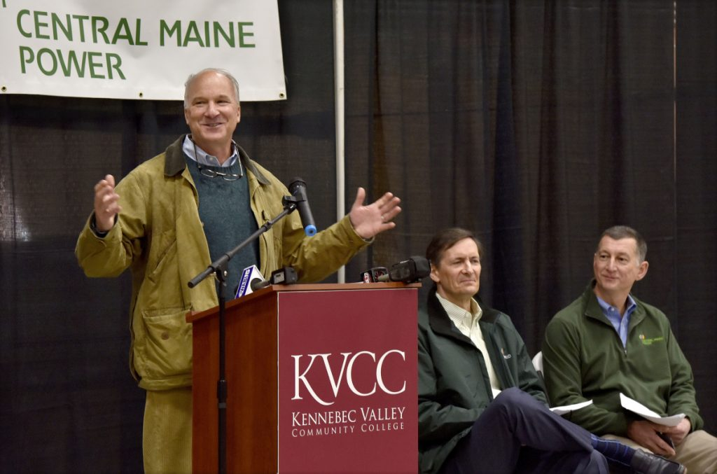 Derek Langhauser, left, president of the Maine Community College System, speaks to students and staff of the Kennebec Valley Community College electrical lineworkers technology program during an open house Wednesday in Fairfield. At right are Robert Kump, of Avangrid, and Doug Herling, of Central Maine Power Co.