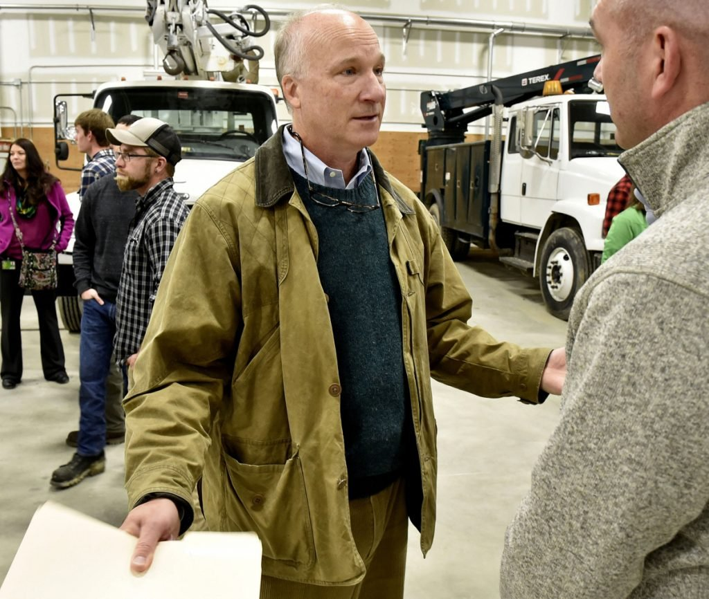 Derek Langhauser, left, president of the Maine Community College System, speaks with Dwight Littlefield during an open house Wednesday in the expanded electrical lineworkers technology program at Kennebec Valley Community College in Fairfield.