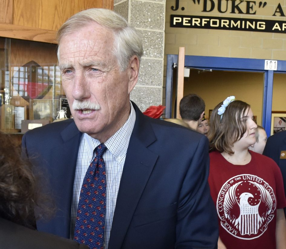 U.S. Sen. Angus King speaks with reporters Thursday after a Messalonskee Middle School Veterans Day assembly at Messalonskee High School in Oakland.