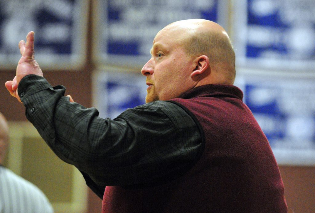 Monmouth girls basketball coach Scott Wing shouts instructions to his team against Searsport during a 2017 Class C South prelim game in Monmouth.
