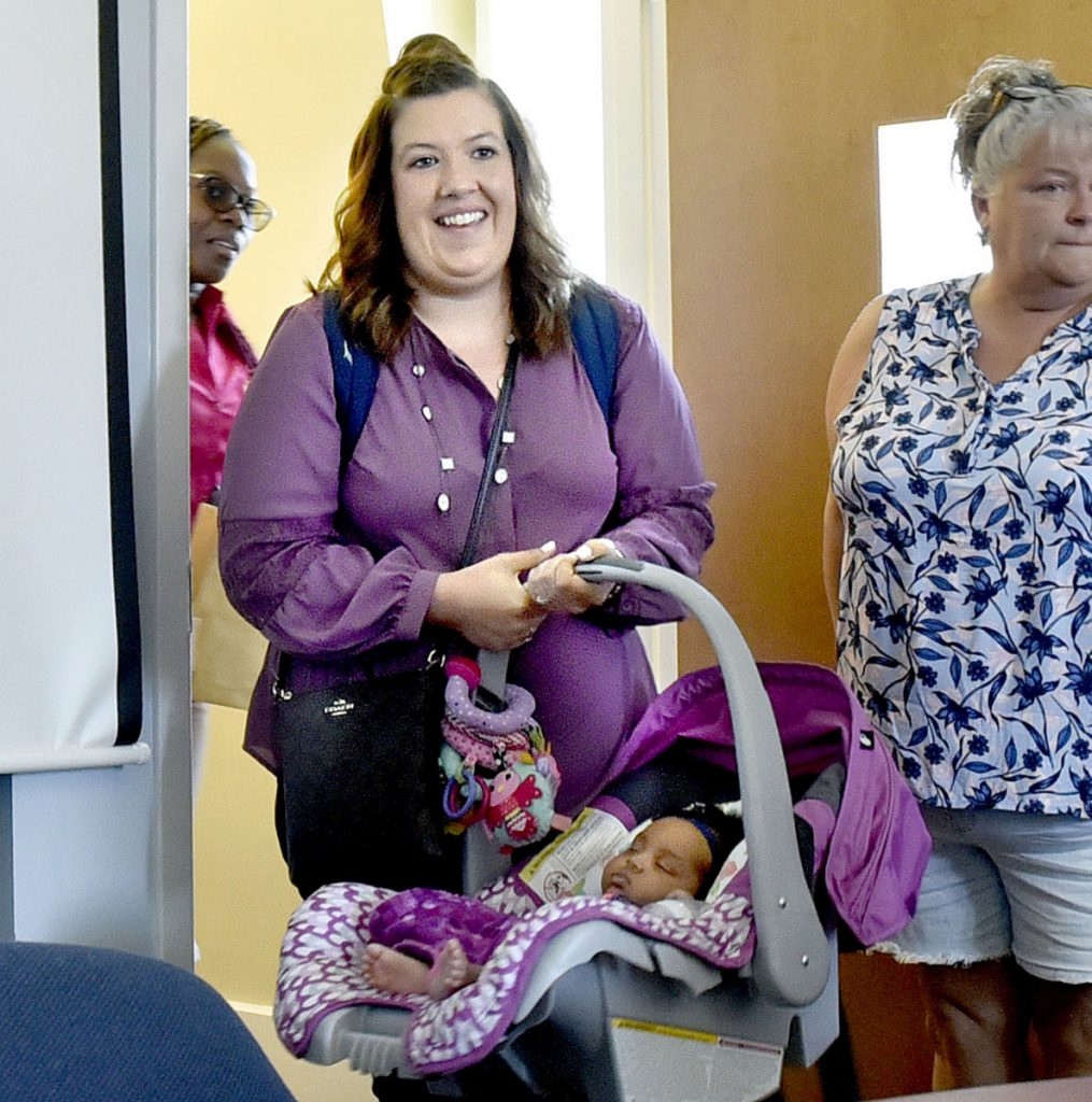 Mindy Saint Martin is seen July 19 with her infant daughter, Mya, for a hearing with the Department of Corrections Pardon Board in Augusta regarding a pardon for her husband, Lexius.